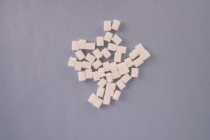 Cube sugar on grey background stock photo
