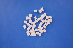 Cube sugar on navy background stock photo