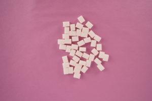Cube sugar on rose background stock photo