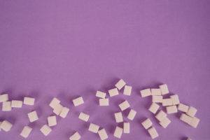 Lump sugar on purple stock photo